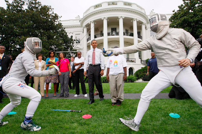 President Obama on the White House lawn watching Olympian Fencer Tim Morehouse and U.S. National Team Fencer Daria Schneider fence. Photo courtesy of AP
