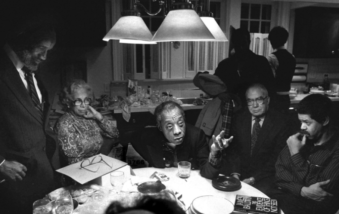 James Baldwin talking with friends in Chicago, Illinois 1984. Photo taken by Michelle Agins and courtesy of MFON.