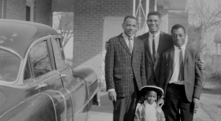 Medgar Evers at home with James Baldwin and his two sons.