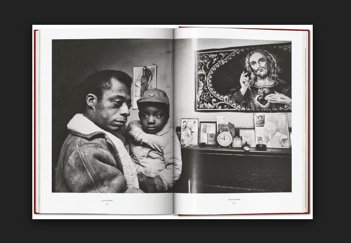 James Baldwin holding an abandoned young boy in Durham, North Carolina. Photo courtesy of Steve Schapiro.