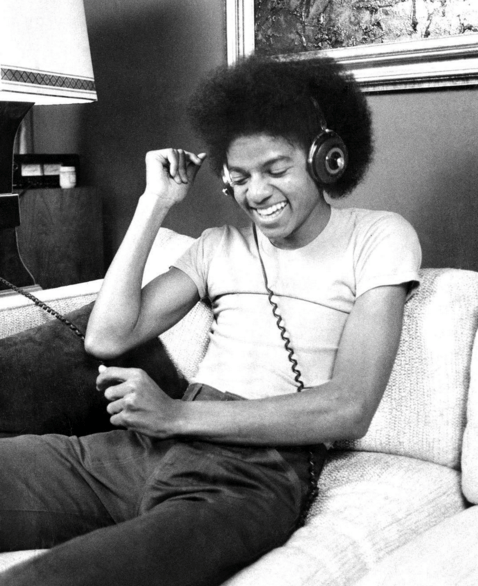 Photo of a young Michael Jackson listening to music via Rolling Stone magazine's Instagram.